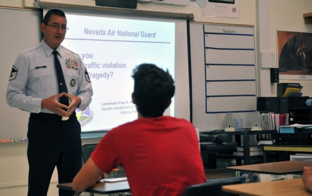 Master Sgt. Paul Hinen, Nevada Air National Guard recruiting and retention manager, presents a traffic safety course at Reno High on July 14. Photo by Tech. Sgt. Emerson Marcus
