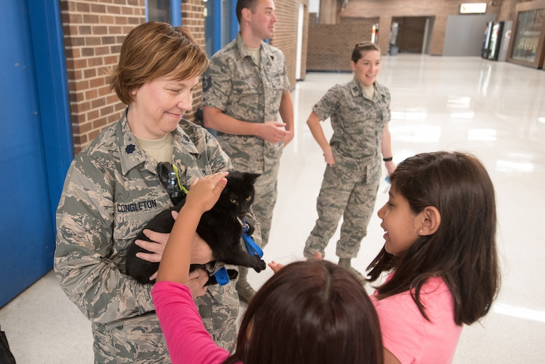 Lt. Col. Carolyn Congleton (left), chief of public health from the Kentucky Air National Guard's 123rd Medical Group, holds a kitten from the Mayfield-Graves County Animal Shelter at Graves County High School in Mayfield, Ky., on July 26, 2016, during Bluegrass Medical Innovative Readiness Training. Congleton conducted a free pet safety seminar to residents of Western Kentucky as part of the IRT.  The Kentucky Air National Guard, U.S. Navy Reserve and other military units are teaming with the Delta Regional Authority to offer medical and dental care at no cost to residents in Mayfield and two other Western Kentucky locations from July 18 to 27 as part of the training event.(U.S. Air National Guard photo by Master Sgt. Phil Speck)