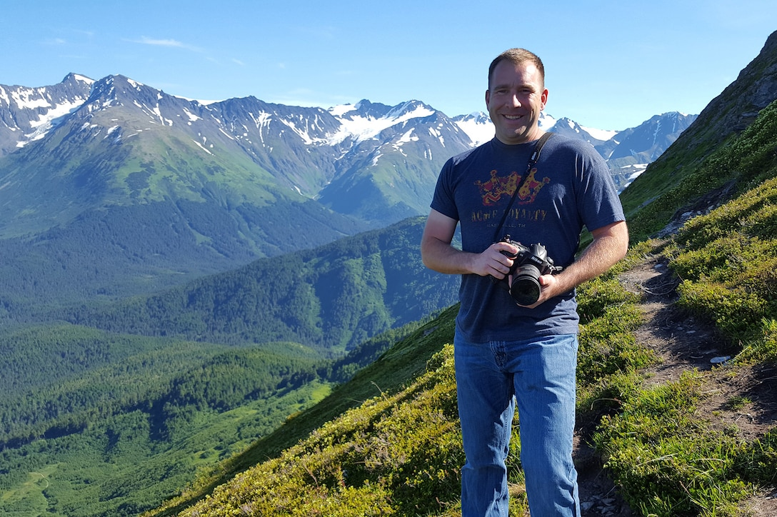 Master Sgt. Jerry Harlan, a photojournalist assigned to the I.G. Brown Training and Education Center, photographs landscapes, July 16, 2016, in Alyeska, Alaska. (U.S. Air National Guard photo by Tech. Sgt. Erik Gallion)