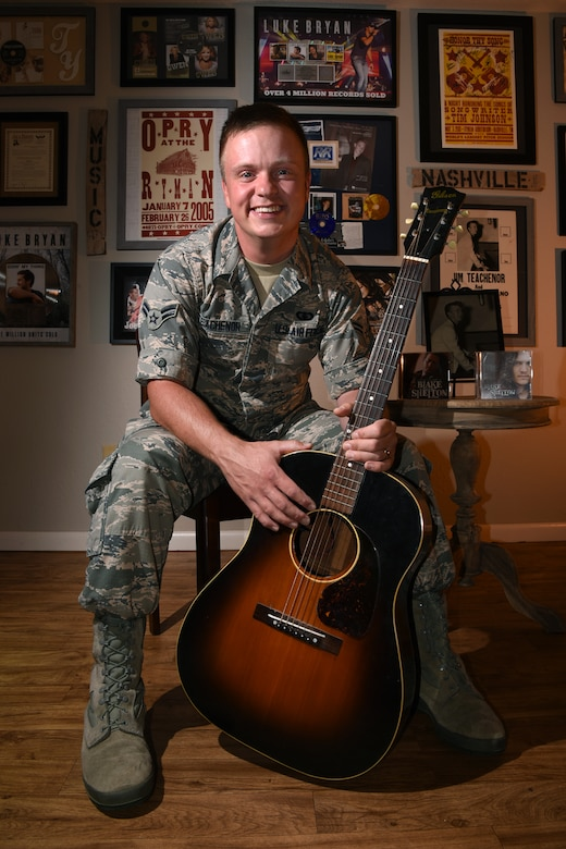 Airman 1st Class Jamie Teachenor, U.S. Air Force Academy Band and Wild Blue Country lead vocalist, displays his gold and platinum records in his home at Peterson Air Force Base, Colo., on July 20, 2016. Teachenor wrote numerous chart-topping songs for some of the most recognizable names in the country music world, including Blake Shelton, Vince Gill, Luke Bryan, Trace Adkins, Montgomery Gentry, Trisha Yearwood, Gretchen Wilson, Blaine Larsen and many more. (U.S. Air Force photo by Airman 1st Class Dennis Hoffman)