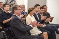 Defense Secretary Ash Carter and audience members applaud following remarks during an announcement at the new Defense Innovation Unit Experimental, or DIUx,  office in Boston,  July 26, 2016. DoD photo by Air Force Tech. Sgt. Brigitte N. Brantley