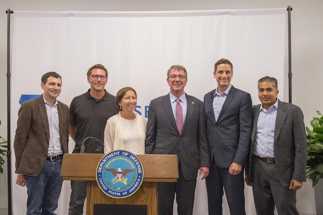 Defense Secretary Ash Carter, center right, poses for a photograph with speakers after a meeting at the new Defense Innovation Unit Experimental, or DIUx,  office in Boston, July 26, 2016. DoD photo by Air Force Tech. Sgt. Brigitte N. Brantley