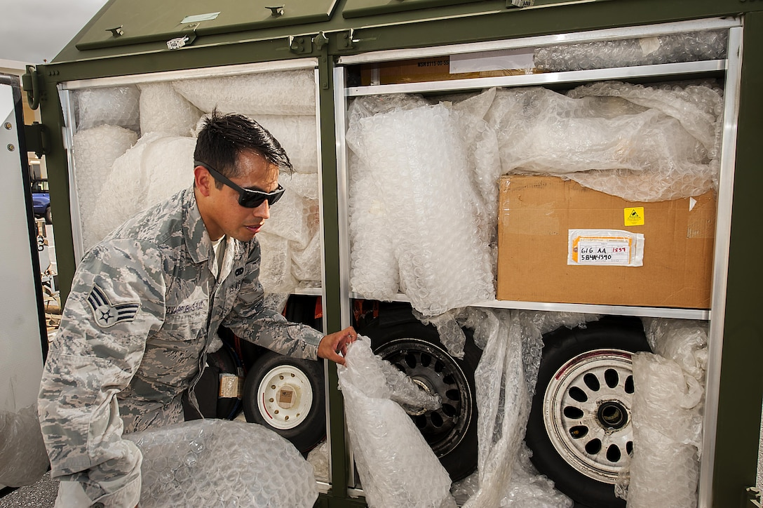 U.S. Air Force Senior Airman Victor Covarrubias-Ruiz, 18th Logistics Readiness Squadron cargo deployment function journeyman, inspects a cargo container July 20, 2016, at Kadena Air Base, Japan. A majority of the cargo the cargo deployment function handles is related to launching jets from a downrange location, though they also handle off-road vehicles, watercraft and humanitarian relief aid. (U.S. Air Force photo by Airman 1st Class Corey M. Pettis)