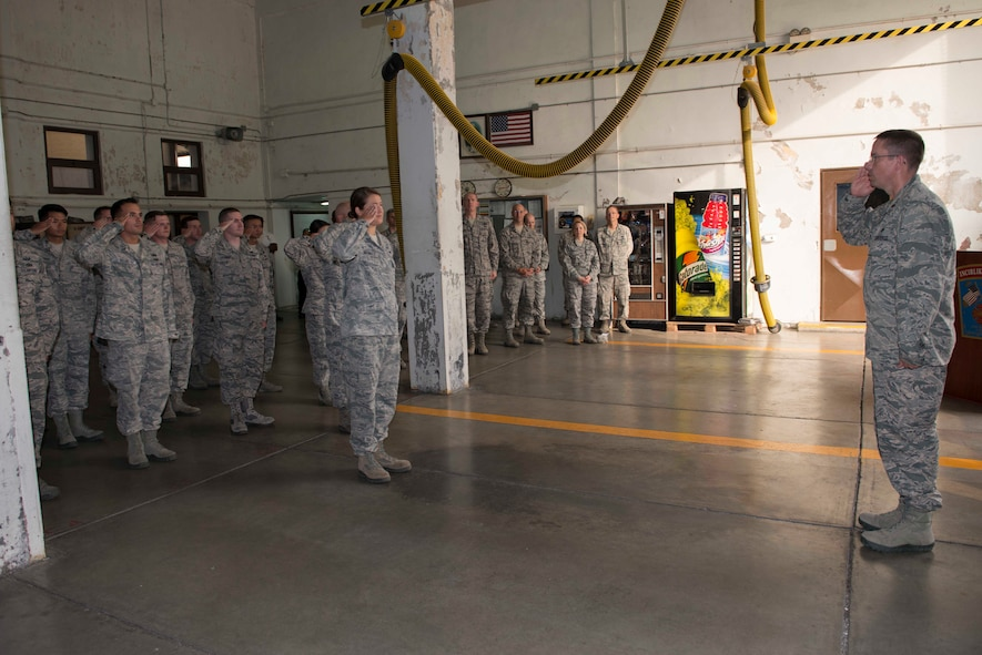 U.S. Air Force Maj. Myles Gilbert, 39th Civil Engineer Squadron (CES) commander, renders his first salute to 39th CES Airmen during a change of command ceremony July 18, 2016, at Incirlik Air Base, Turkey. Gilbert led a 294 member flight that supported 47 host and tenant units at Holloman Air Force Base, New Mexico. (U.S. Air Force photo by Senior Airman John Nieves Camacho)