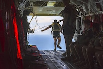 Army Rangers parachute from a CH-47F Chinook helicopter during a water insertion off the coast of Tybee Island, Ga., July 20, 2016. Army photo by Spc. Scott Lindblom