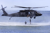 Army Rangers jump from a UH-60M Black Hawk helicopter during a water insertion off the coast of Tybee Island, Ga., July 20, 2016. Army photo by Spc. Scott Lindblom