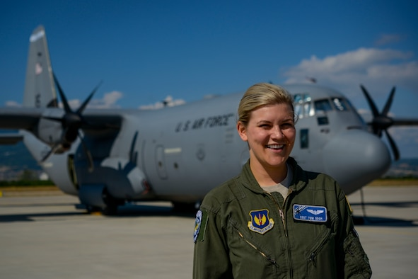 Staff Sgt. Toni Odom, 37th Airlift Squadron loadmaster and Thracian Summer 2016 ramp coordinator, stands in front of a C-130J Super Hercules July 21, 2016, at Plovdiv Airport, Bulgaria. Odom was one of two ramp coordinators for Thracian Summer 2016, where she was in charge of 26 personnel for the two-week forward training deployment. (U.S. Air Force photo/Senior Airman Nicole Keim)