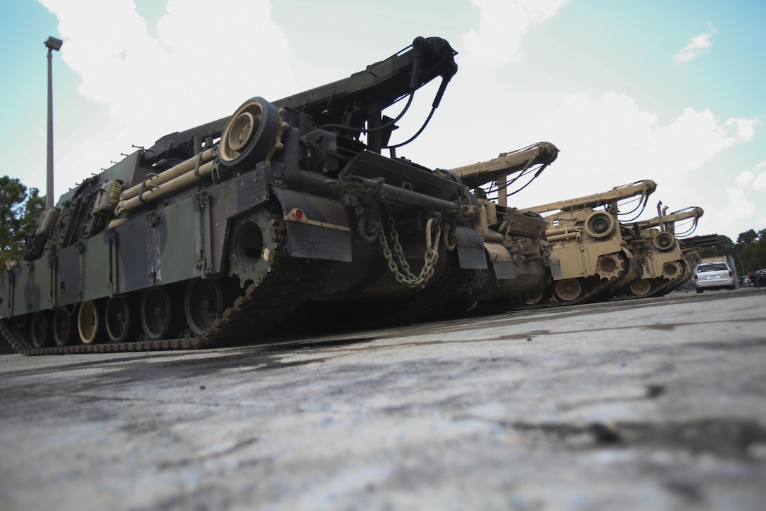 M88 Recovery Vehicles are lined up prior to being moved onto the floor for repairs at 2nd Maintenance Battalion at Camp Lejeune, N.C., July 21, 2016. 2nd Maint. Bn. received the Chesty Puller Award, the Ground Safety Award and the Department of Defense Maintenance Award for the Marines ability to keep up with their work and complete their mission.(U.S. Marine Corps photo by Lance Cpl. Miranda Faughn/Released)