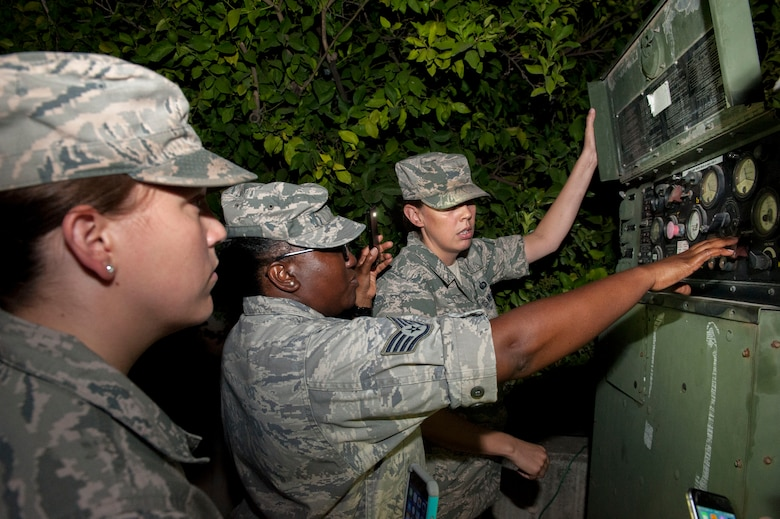 Airmen from the 39th Force Support Squadron check the fuel and energy status of a power generator keeping refrigerators running July 20, 2016, at Incirlik Air Base, Turkey. Due to an extended loss of commercial power to the base, facilities were required to run on internal generated power to sustain operations. (U.S. Air Force photo by Staff Sgt. Jack Sanders)