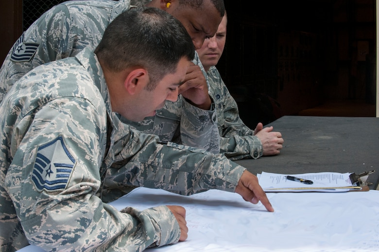 U.S. Air Force Master Sgt. Shawn Slaiman, 39th Civil Engineer Squadron installation management flight chief, discusses facilities being powered by generators July 20, 2016, at Incirlik Air Base, Turkey. Due to an extended loss of commercial power to the base, facilities were required to run on internal generated power to sustain operations. (U.S. Air Force photo by Staff Sgt. Jack Sanders)
