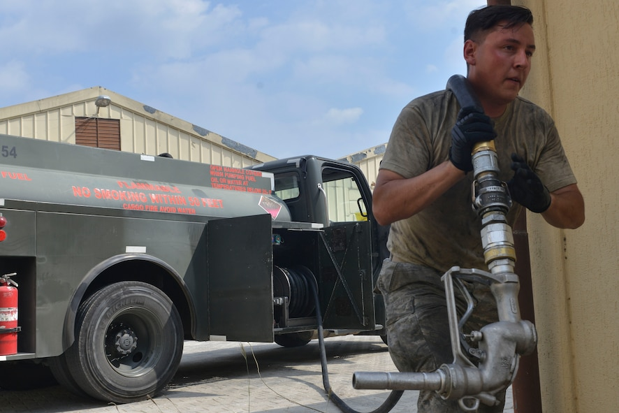 U.S. Air Force Airman 1st Class Trenton Beard, 39th Logistics Readiness Squadron fuels specialist, carries a hose to a generator July 19, 2016, at Incirlik Air Base, Turkey. Base personnel worked to keep electrical power supplied to the installation, ensuring mission readiness. (U.S. Air Force photo by Senior Airman John Nieves Camacho)