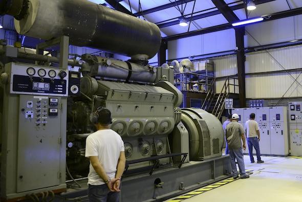 Contractors from the 39th Civil Engineer Squadron monitor a power plant generator July 20, 2016, at Incirlik Air Base, Turkey. Internal power was used due to an extended loss of commercial power to sustain missions here at Incirlik. (U.S. Air Force photo by Tech. Sgt. Caleb Pierce)