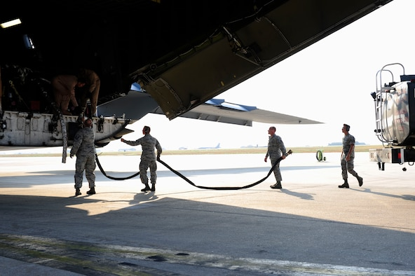 Airmen from the 39th Logistics Readiness Squadron, download fuel from a U.S. Air Force C-5M Super Galaxy July 22, 2016, at Incirlik Air Base, Turkey. Due to an extended loss of commercial power to the base, supplies, including food, water and fuel were delivered to sustain missions here at Incirlik. (U.S. Air Force photo by Airman 1st Class Devin M. Rumbaugh)