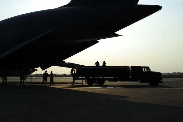 Airmen assigned to the 39th Logistics Readiness Squadron, unload fuel from a U.S. Air Force C-5M Super Galaxy July 22, 2016, at Incirlik Air Base, Turkey. Due to an extended loss of commercial power to the base, supplies, including food, water and fuel were delivered to sustain missions here at Incirlik. (U.S. Air Force photo by Airman 1st Class Devin M. Rumbaugh)