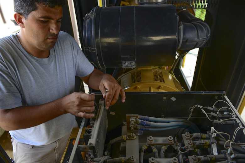 A 39th Civil Engineer Squadron contractor performs maintenance on a generator July 21, 2016, at Incirlik Air Base, Turkey. Maintenance was performed on multiple generators across the base that were used during a commercial power loss. (U.S. Air Force photo by Tech. Sgt. Caleb Pierce)
