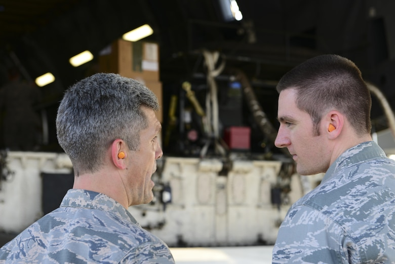 U.S. Air Force Lt. Col. Nathan Mansfield, 728th Air Mobility Squadron commander, speaks with Capt. Brian Jorgensen, 39th Logistics Readiness Squadron operations officer, about the aerial bulk fuel delivery system aboard a C-5M Super Galaxy July 22, 2016, at Incirlik Air Base, Turkey. The fuel system can hold up to 3,000 gallons of fuel. (U.S. Air Force photo by Tech. Sgt. Caleb Pierce)