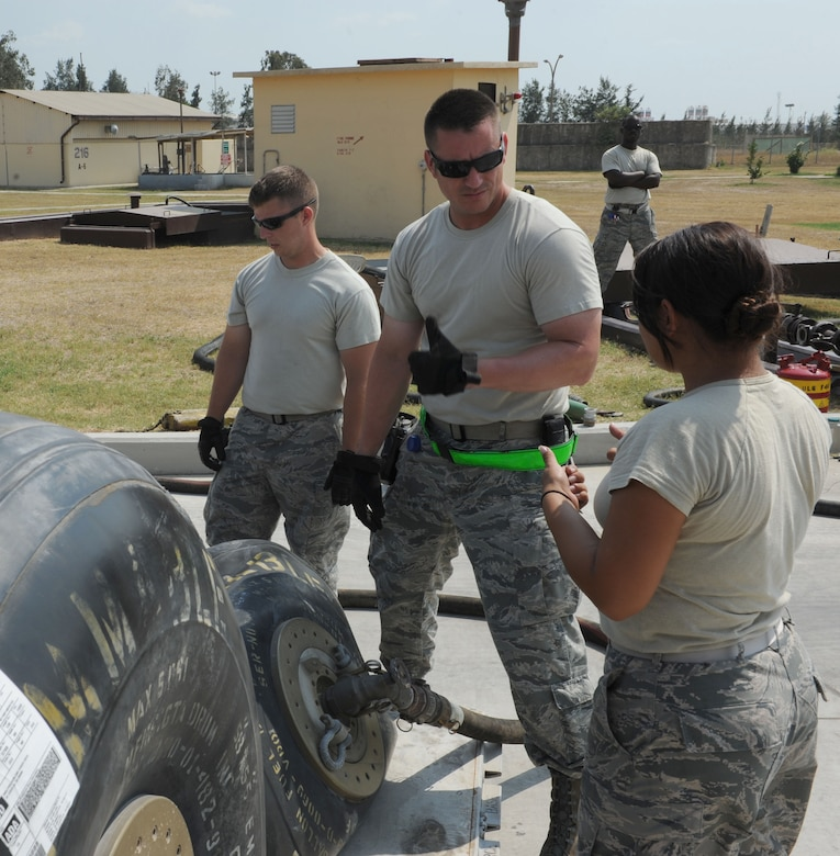 U.S. Air Force Staff Sgt. Christian Crider, (left), Tech. Sgt. Tony Otis, Staff Sgt. Brandon Jenkins and Senior Airman Samantha Perez, 39th Logistics Readiness Squadron petroleum oils and lubricants flight Airmen, unload fuel from bladders into bulk storage July 22, 2016, at Incirlik Air Base, Turkey. Due to an extended loss of commercial power to the base, supplies, including food, water and fuel were delivered to sustain missions here at Incirlik. (U.S. Air Force photo by Staff Sgt. Jack Sanders)