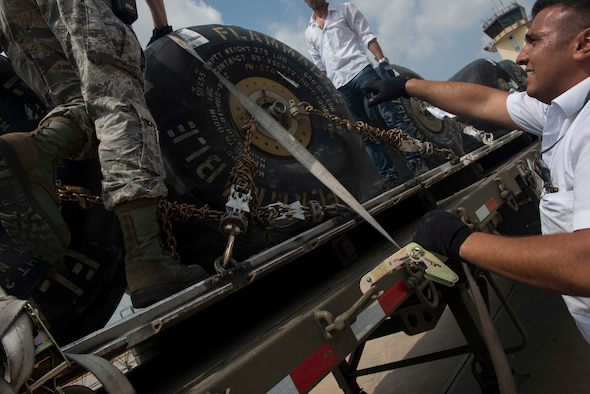 Members of the 728th Air Mobility Squadron work together to secure fuel bladders for transport July 22, 2016, at Incirlik Air Base Turkey. The fuel bladders were transported and dispensed into a bulk fuel storage. (U.S. Air Force photo by Senior Airman John Nieves Camacho)