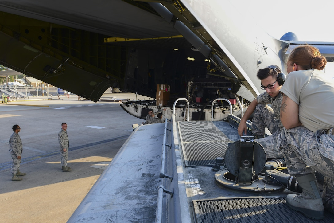 Airmen from the 39th Logistics Readiness Squadron fuels flight, receive fuel from a bladder off a U.S. Air Force C-5M Super Galaxy July 22, 2016, at Incirlik Air Base, Turkey. After an extended loss of commercial power to the base, supplies, including food, water and fuel, were delivered to sustain missions here at Incirlik. (U.S. Air Force photo by Tech. Sgt. Caleb Pierce)