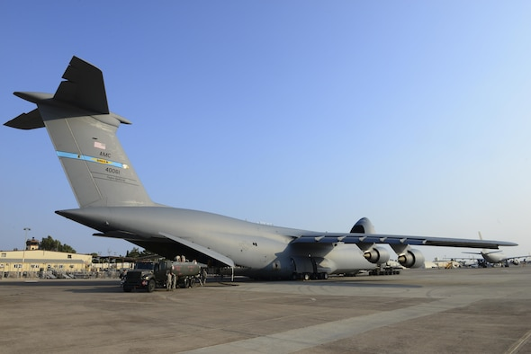 Fuel and supplies are unloaded from a U.S. Air Force C-5M Super Galaxy July 22, 2016, at Incirlik Air Base, Turkey. Due to an extended loss of commercial power, food, fuel and other supplies were sent to Incirlik to sustain missions here at Incirlik. (U.S. Air Force photo by Tech. Sgt. Caleb Pierce)