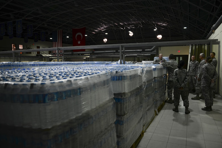 U.S. Air Force Col. John Walker, 39th Air Base Wing commander, meets with 39th Logistics Readiness Squadron Airmen during a site survey July 23, 2016, at Incirlik Air Base, Turkey. Walker visited multiple sites to check on supplies received during a recent commercial power loss. (U.S. Air Force photo by Tech. Sgt. Caleb Pierce)