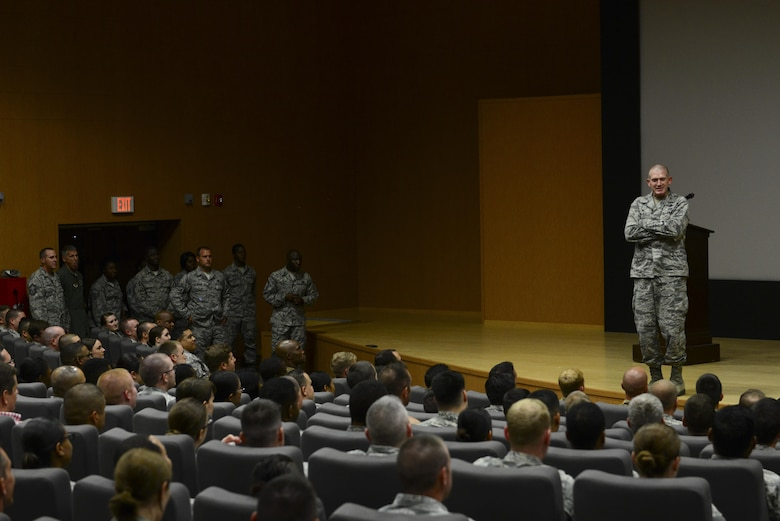 U.S. Air Force Col. John Walker, 39th Air Base Wing commander, addresses wing personnel about recent conditions July 24, 2016, at Incirlik Air Base, Turkey. Walker expressed his gratitude for the hard work and dedication of the men and women serving at Incirlik. (U.S. Air Force photo by Tech. Sgt. Caleb Pierce)