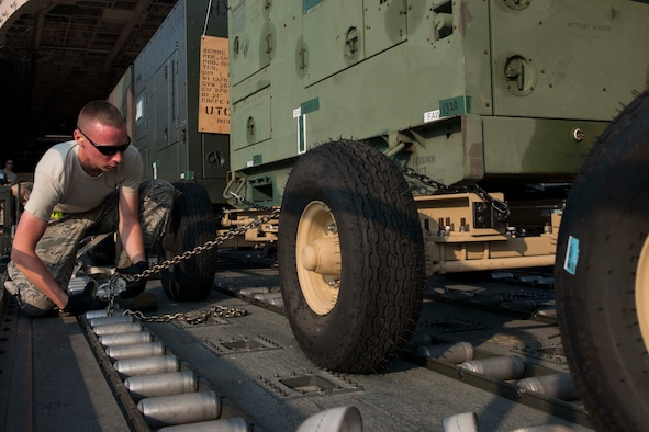 U.S. Air Force Senior Airman Kevin Paquin, 728th Air Mobility Squadron air transportation journeyman, secures a generator for transport July 22, 2016, at Incirlik Air Base Turkey. The generators were used to supply power to base facilities. (U.S. Air Force photo by Senior Airman John Nieves Camacho)