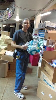 "William Noel oversaw the distribution of more than 8,000 bottles of water during the ""Your Best Pathway to Health"" event July 12-14 in Beckley, West Virginia."