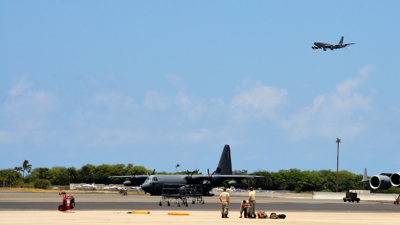 JOINT BASE PEARL HARBOR-HICKAM - U.S. Air Force maintenance crews with the 507th Aircraft Maintenance Squadron at Tinker Air Force Base, Okla., prepare to recover the KC-135R Stratotanker pictured landing overhead following an aerial refueling mission as part of Rim of the Pacific 2016. (U.S. Air Force photo\Tech. Sgt. Lauren Gleason)