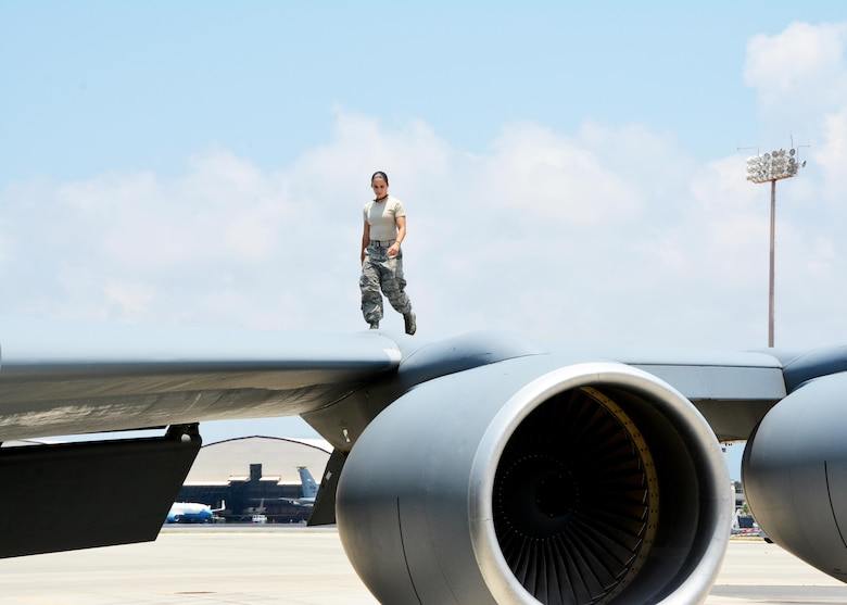 160917-EW270-084 JOINT BASE PEARL HARBOR-HICKAM (July 19, 2016) U.S. Air Force Senior Airman Nathalie Hamilton, a crew chief with the 507th Maintenance Squadron at Tinker Air Force Base, Okla., walks the along a wing of a KC-135R Stratotanker as part of a thru-flight inspection during Rim of the Pacific 2016. (U.S. Air Force photo\Tech. Sgt. Lauren Gleason)