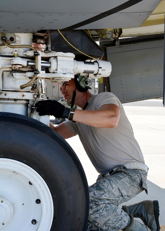 JOINT BASE PEARL HARBOR-HICKAM - Tech Sgt. Michael Dunning, crew chief with the 507th Aircraft Maintenance Squadron at Tinker Air Force Base, Okla., performs a nose landing gear inspection following an aerial refueling mission as part of Rim of the Pacific 2016. (U.S. Air Force photo\Tech. Sgt. Lauren Gleason)
