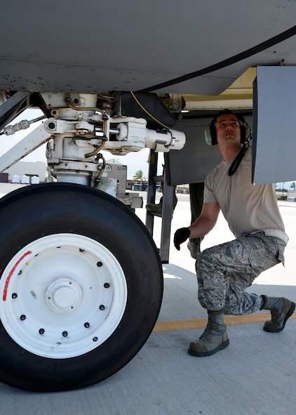 JOINT BASE PEARL HARBOR-HICKAM - Tech Sgt. Michael Dunning, crew chief with the 507th Aircraft Maintenance Squadron at Tinker Air Force Base, Okla., performs a nose landing gear inspection following an aerial refueling mission as part of Rim of the Pacific 2016. Twenty-six nations, more than 40 ships and submarines, more than 200 aircraft, and 25,000 personnel are participating in RIMPAC from June 30 to Aug. 4, in and around the Hawaiian Islands and Southern California. (U.S. Air Force photo\Tech. Sgt. Lauren Gleason)