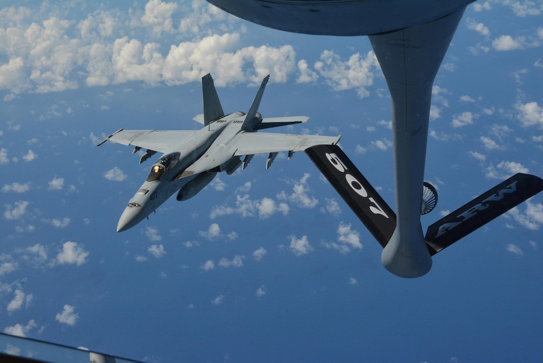 160720-F-EW270-219 JOINT BASE PEARL HARBOR-HICKAM (July 20, 2016) A U.S. Navy F-18 Hornet prepares to receive fuel from a KC-135R Stratotanker assigned to the 465th Air Refueling Squadron at Tinker Air Force Base, Okla during Rim of the Pacific 2016. (U.S. Air Force photo\Tech. Sgt. Lauren Gleason)