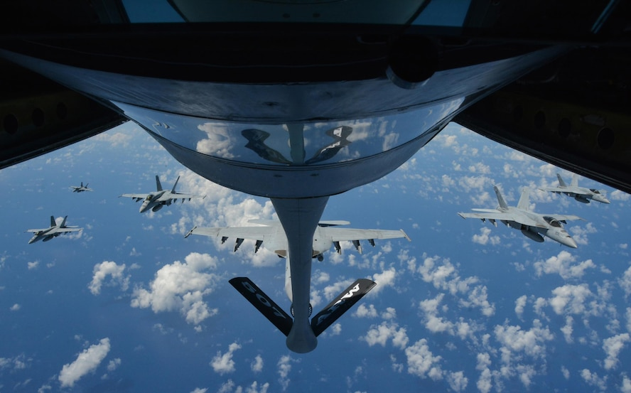 JOINT BASE PEARL HARBOR-HICKAM - Six U.S. Navy F-18 Hornets await refueling from a KC-135R Stratotanker belonging to the 465th Air Refueling Squadron at Tinker Air Force Base, Okla., during Rim of the Pacific 2016. (U.S. Air Force photo/Tech. Sgt. Lauren Gleason)
