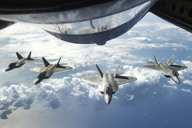 Four F-22 Raptors await refueling from a KC-135R Stratotanker aircraft during Rim of the Pacific 2016 over the Pacific Ocean, July 26, 2016. The Raptor pilots are assigned to the 199th and 19th Fighter squadrons. Navy photo by Petty Officer 2nd Class Gregory A. Harden II