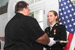 Marine Corps 2nd Lt. Rebecca Reynolds (Horwath) receives the ceremonial Mameluke Sword from her father, Edward Horwath, during her commissioning ceremony in the University Club at the University of Alabama, Tuscaloosa, Ala., July 15, 2016. Reynolds joined the Platoon Leaders Class her freshman year and was later selected in the PLC Juniors and again in PLC Seniors in 2015. Reynolds is a native of Muskego, Wis. Marine Corps photo by Cpl. Diamond N. Peden