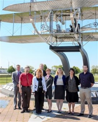 The Non-DoD Military Aircraft Office at Wright-Patterson Air Force Base gather at the Wright Brothers memorial. The office is the Air Force's latest innovative concept for supporting airworthiness assessments. Members of the office include (from left to right) Rob Lymangrover, Keith Quinn, Jane White, Bob FitzHarris, Victoria Russell, Jennifer Miller, Joy Williams, Alex Kreider Not pictured: Ronnie Rawls and Ruby Schrader. (Contributed photo)