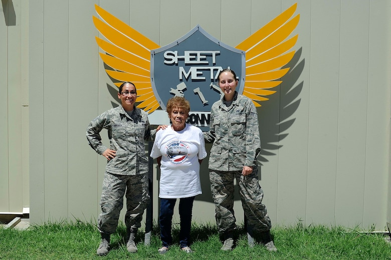 Master Sgt. Elizabeth Sarabia, 931st Maintenance Squadron aircraft structural maintenance section chief, left, and Senior Airman Ciarra White, 22nd Maintenance Squadron ASM journeyman, right, pose with Connie Palacioz, a riveter during World War II, July 20, 2016, at McConnell Air Force Base, Kan. Palacioz recently visited the base sheet metal shop where she received a tour and spoke with Airmen. (U.S. Air Force photo/Airman 1st Class Jenna K. Caldwell)