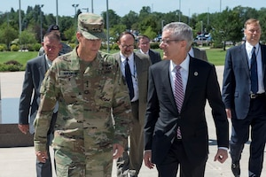 Lt. Gen. Daniel Hokanson, Deputy Commander of U.S. Northern Command, and Mr. Peter Neffenger, Administrator for the Transportation Security Administration, talk just before entering headquarters of North American Aerospace Defense Command and USNORTHCOM.  Neffenger was at the command talking with senior NORAD and USNORTHCOM officials on the importance of current information sharing between TSA and the two commands and to share Neffenger's vision for mitigating current and future threats to transportation both in the homeland and abroad.