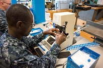 Navy Petty Officer 2nd Class Samuel Addo-Donkoh prepares lenses for a patient during the Greater Chenango Cares Innovative Readiness Training in Cortland, N.Y., July 18, 2016. Addo-Donkoh is a hospitalman assigned to the Naval Ophthalmic Support and Training Activity. Air National Guard photo by Senior Master Sgt. Elizabeth Gilbert