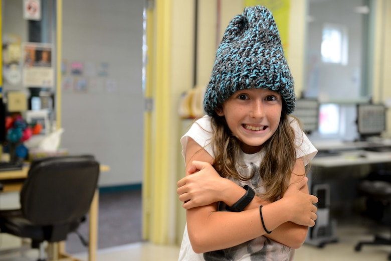 Elizabeth Lewis, 10, sports a cap sewn by a sewing camp participant at the Two Rivers Youth Center at Joint Base Elmendorf-Richardson, Alaska, July 21, 2016. Sewing camp is offered every summer at Two Rivers. (U.S. Air Force photo by Airman 1st Class Javier Alvarez)