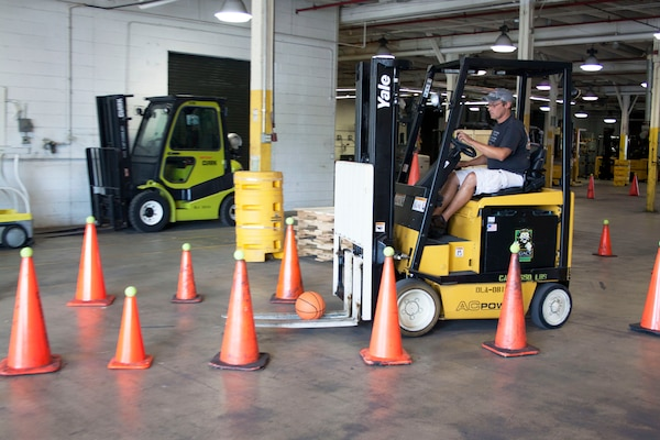 Daniel Ickes, DLA Distribution Susquehanna West Bulk employee maneuvers his forklift and basketball through a tight, windy section of cones during the Susquehanna Forklift Rodeo on July 20.