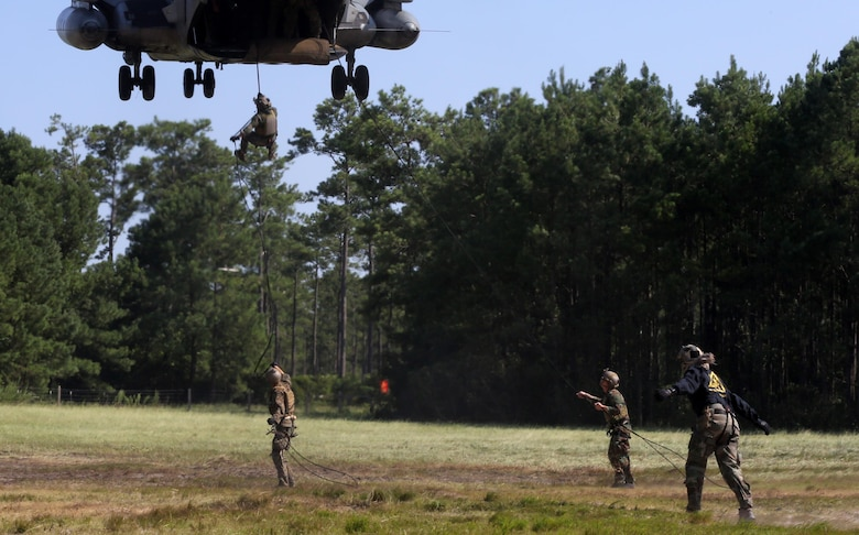Marines with U.S. Marine Corps Forces Special Operations Command conduct a fast rope and rappelling course on Landing Zone Parrot at Marine Corps Base Camp Lejeune, N.C., July 20, 2016. The exercise was part of a two weeklong Helicopter Insertion and Extraction Techniques Course. The CH-53 provided for the training evolution was assigned to Marine Heavy Helicopter Squadron 461, 2nd Marine Aircraft Wing. (U.S. Marine Corps photo by Lance Cpl. Mackenzie Gibson/Released)