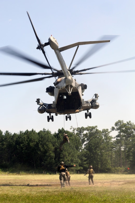 Marines with U.S. Marine Corps Forces Special Operations Command complete a fast rope and rappelling course on Landing Zone Parrot at Marine Corps Base Camp Lejeune, N.C., July 20, 2016. The exercise was a part of a two weeklong Helicopter Insertion and Extraction Techniques Course. The CH-53 provided for the training evolution was assigned to Marine Heavy Helicopter Squadron 461, 2nd Marine Aircraft Wing. (U.S. Marine Corps photo by Lance Cpl. Mackenzie Gibson/Released)