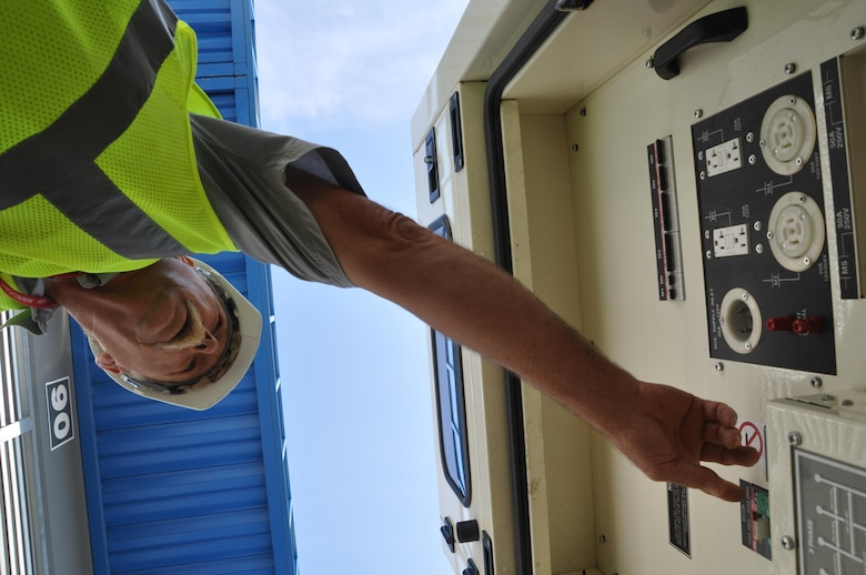 A contractor checks systems on a generator awaiting installation during a regional power mission exercise conducted July 20 at the Federal Emergency Management Agency Distribution Center in Atlanta, Georgia.