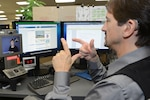 Michael Botte uses a video communication device provided through the Computer/Electronic Accommodations Program to make a call at Edwards Air Force Base, Calif., Sept. 22, 2014. Air Force photo by Jet Fabara
