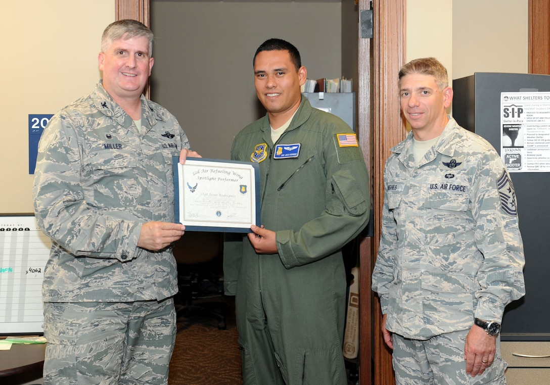 Staff Sgt. Jesus Rodriguez, 22nd Operations Group unit deployment manager and boom operator, poses with Col. Albert Miller, 22nd Air Refueling Wing commander, and Chief Master Sgt. Shawn Hughes, 22nd ARW command chief, July 19, 2016, at McConnell Air Force Base, Kan. Rodriguez received the spotlight performer for the week of May 23-27. (U.S. Air Force photo/Senior Airman David Bernal Del Agua)
