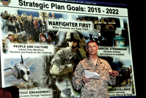 DLA Director Air Force Lt. Gen. Andy Busch updates employees on progress toward the agency's strategic plan and results of the 2016 Culture Survey during a town hall at the McNamara Headquarters Complex July 27.