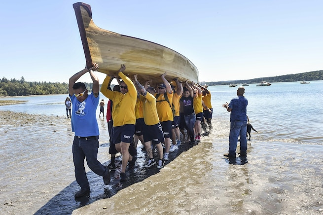 Sailors assist in transporting a tribal canoe, some weighing more than 1,500 pounds, during a canoe landing the Port Gamble S'Klallam Tribe hosted for Pacific Northwest tribes in Kingston, Wash., July 24, 2016. The sailors are assigned to Naval Base Kitsap. Navy photo by Petty Officer 2nd Class Cory Asato