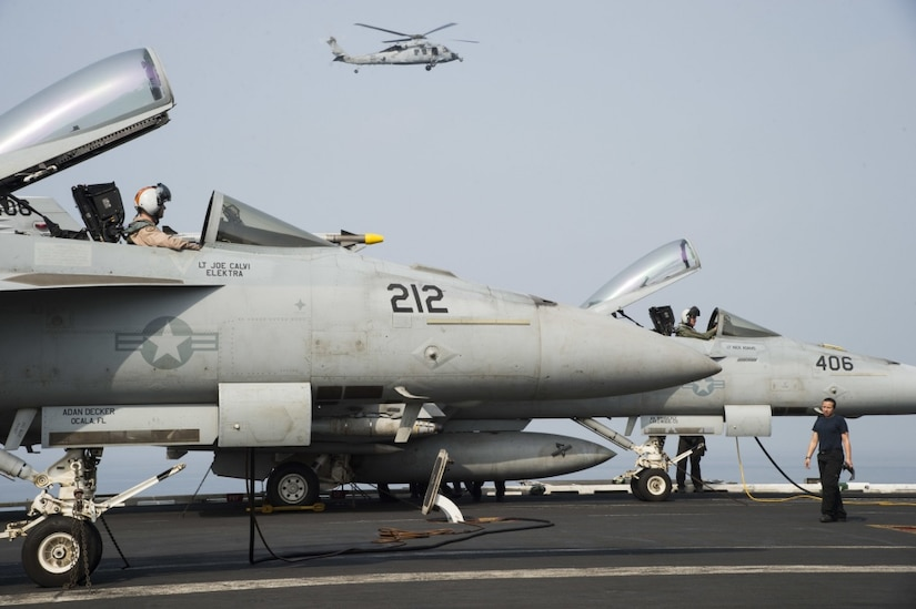 Two F/A-18E Super Hornets undergo preliminary checks on the flight deck of the aircraft carrier USS Dwight D. Eisenhower   in the Arabian Gulf, July 26, 2016. The USS Eisenhower and its Carrier Strike Group are deployed in support of Operation Inherent Resolve, maritime security operations and theater security cooperation efforts in the U.S. 5th Fleet area of operations. Navy photo by Petty Officer 3rd Class Theodore Quintana